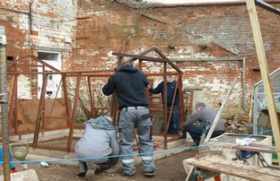 Reconstructing the donated cedar greenhouse