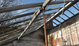The peach house roof before covering with the protective tarpaulin
